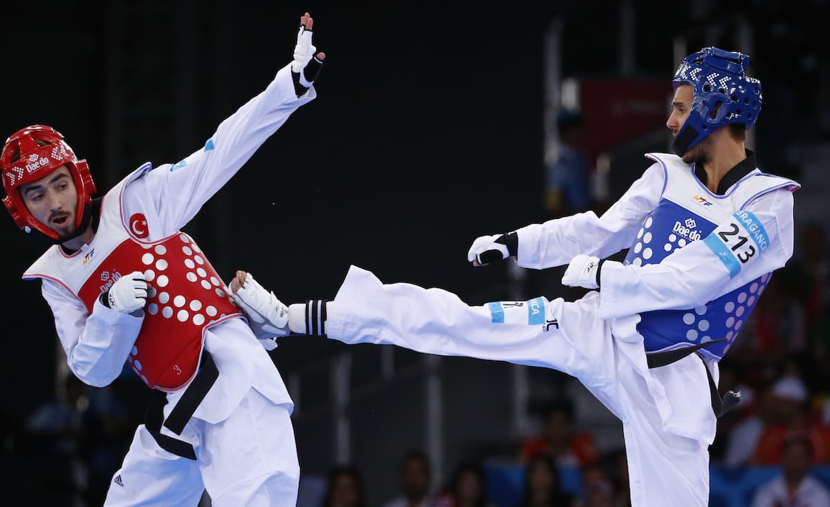 Braganca of Portugal and Sezer of Turkey fight during their men's 58kg preliminary round taekwondo match at the 1st European Games in Baku